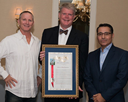 Outgoing CWA President Greg Milleman and 2017-18 CWA President Lawrence Morales Accepting the California Assembly Resolution from Assembly Member Mark Stone (D-Santa Cruz) Honoring CWA on its 75th Anniversary