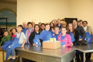 SJWC employees and their family members, young and old, pitch in to help feed the hungry at Martha's Kitchen.
