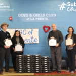 Suburban Water Systems donates 42 refurbished laptops to Boys & Girls Club